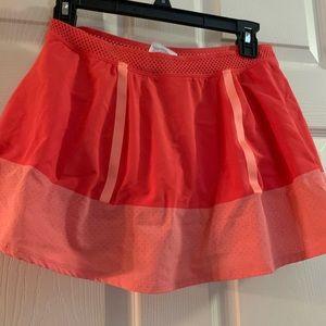 Orange Nike tennis skirt